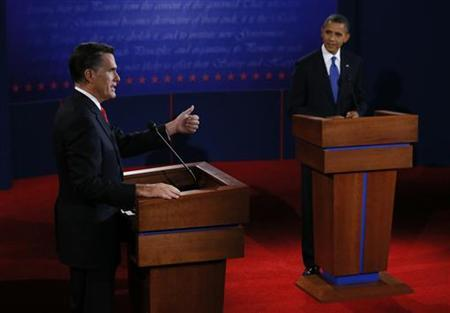 Republican presidential nominee Mitt Romney answers a question as President Barack Obama listens during the first 2012 U.S. presidential debate in Denver October 3, 2012. REUTERS/Rick Wilking