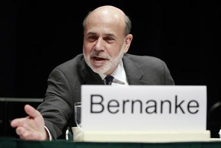 U.S. Federal Reserve Chairman Ben Bernanke leans forward to speak with someone before addressing the Economic Club of Indiana in Indianapolis October 1, 2012. REUTERS/Brent Smith