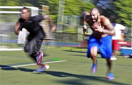 Jyles Tucker (R) and Legedu Naanee run sprints during workouts with other NFL hopefuls at the Bommarito Performance Systems facility in North Miami Beach, Florida October 4, 2012. REUTERS/Joe Skipper