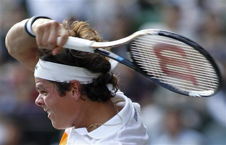 Milos Raonic of Canada follows through on a shot against Andy Murray of Britain at the men's singles semi-finals match at the Japan Open tennis championships in Tokyo, October 6, 2012. REUTERS/Yuriko Nakao
