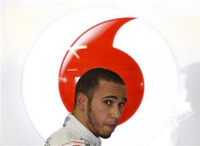 McLaren Formula One driver Lewis Hamilton of Britain stands in the team garage during the third practice session of the Japanese F1 Grand Prix at the Suzuka circuit October 6, 2012. REUTERS/Kim Kyung-Hoon
