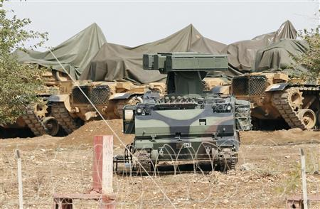 A mobile missile launcher is positioned at a military base on the Turkish-Syrian border at Suruc in Sanliurfa province, October 6, 2012. REUTERS/Murad Sezer