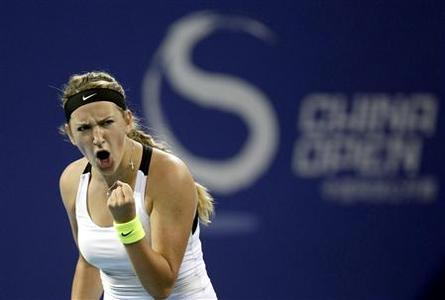 Belarus's Victoria Azarenka reacts after winning a point during her semi-final women's singles match against France's Marion Bartoli at the China Open tennis tournament in Beijing October 6, 2012. REUTERS/Jason Lee