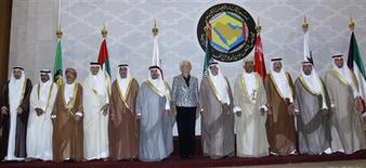 International Monetary Fund (IMF) Managing Director Christine Lagarde (C) Bahrain's Finance Minister Ahmed bin Mohammed Al Khalifa, (center L)and Saudi Arabia's Finance Minister Ibrahim al-Assaf, (center R) and other Arab Gulf officials pose before the Gulf Cooperation Council (GCC) Finance Ministers meeting in Riyadh October 6,2012. REUTERS/Fahad Shadeed