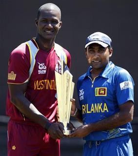 Sri Lanka's captain Mahela Jayawardene (R) and West Indies captain Darren Sammy pose with the International Cricket Council Twenty20 World Cup trophy ahead of their final match in Colombo, October 6, 2012. REUTERS/Dinuka Liyanawatte