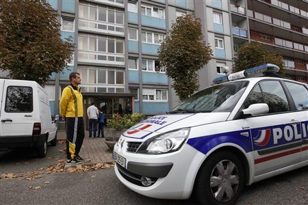 A police car is seen parked in front of a building in the Esplanade suburb of Strasbourg October 6, 2012. REUTERS/Vincent Kessler