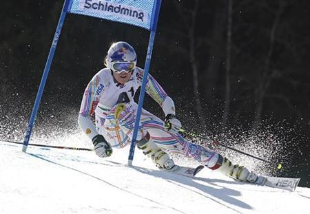 Lindsey Vonn of the U.S. clears a gate during the women's alpine skiing giant slalom race at the World Cup finals in Schladming March 18, 2012. REUTERS/Lisi Niesner
