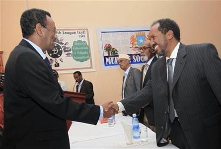 Somalia's President Hassan Sheikh Mohamud (R) meets his newly appointed Prime Minister Abdi Farah Shirdon Saaid (L) in Somalia's capital Mogadishu October 6, 2012. Somali President Mohamud has named Saaid as the country's new prime minister, diplomats and a government source said, the first major decision by an administration installed after over 20 years of conflict. REUTERS/Feisal Omar