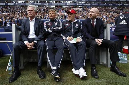 Bayern Munich's coach Jupp Heynckes, assistant coach Peter Hermann, Hermann Gerland and manager Matthias Sammer (L-R) sit on the bench before the German first division Bundesliga football match against Sckalke 04 in Gelsenkirchen September 22, 2012. REUTERS/Ina Fassbender