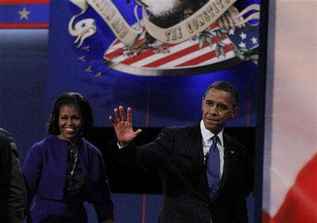 President Barack Obama waves as he and his wife Michelle depart the stage after the end of the first presidential debate against Republican presidential nominee Mitt Romney in Denver October 3, 2012. REUTERS/Jim Urquhart