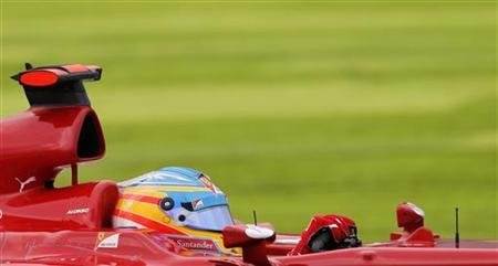 Ferrari Formula One driver Fernando Alonso of Spain drives during the qualifying session of the Japanese F1 Grand Prix at the Suzuka circuit October 6, 2012. REUTERS/Kim Kyung-Hoon
