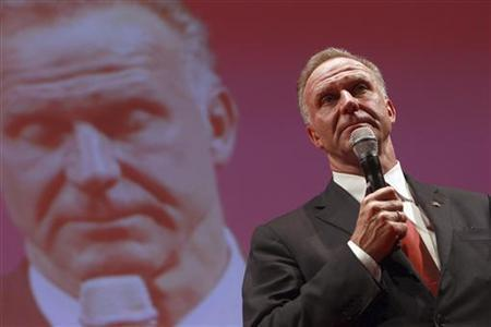 CEO of Bayern Munich Karl-Heinz Rummenigge gives a speech during a party of the soccer club in Munich May 20, 2012. REUTERS/Alexander Hassenstein/Pool/Files