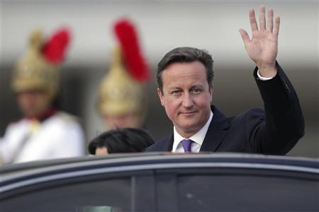 Britain's Prime Minister David Cameron waves as he leaves after a meeting with Brazil's President Dilma Rousseff at the Planalto Palace in Brasilia September 28, 2012. REUTERS/Ueslei Marcelino