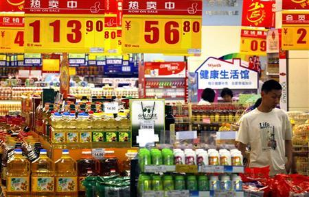 A customer looks at products on sale at a supermarket in central Beijing June 12, 2012. REUTERS/David Gray