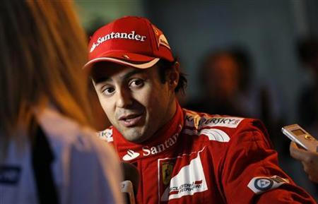 Ferrari Formula One driver Felipe Massa of Brazil talks to media following the Japanese F1 Grand Prix at the Suzuka circuit October 7, 2012. REUTERS/Toru Hanai