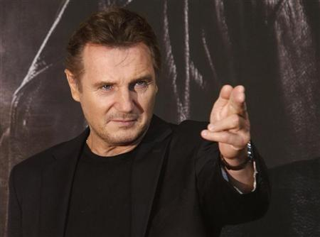 Actor Liam Neeson poses before a news conference to promote his movie, ''Taken 2'' in Seoul September 17, 2012. REUTERS/Kim Hong-Ji (SOUTH KOREA - Tags: ENTERTAINMENT)