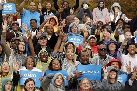 Supporters cheer for ''four more years'' as U.S. President Barack Obama speaks during a campaign rally in Cleveland, Ohio October 5, 2012. REUTERS/Kevin Lamarque