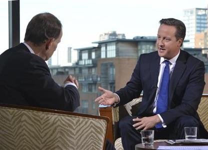 Britain's Prime Minister David Cameron speaks on the BBC's Andrew Marr Show, during the Conservative Party annual conference, in Birmingham, central England October 7, 2012. REUTERS/Jeff Overs/BBC/Handout