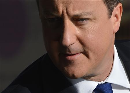 Britain's Prime Minister David Cameron arrives at the Conservative Party conference in Birmingham, central England October 7, 2012. REUTERS/Toby Melville