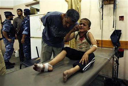 A wounded Palestinian boy speaks on the phone with his family following an Israeli air strike in Rafah camp in the southern Gaza Strip October 7, 2012. A missile fired by an Israeli aircraft hit and wounded two Palestinian militants and eight bystanders in the southern Gaza Strip on Sunday, Palestinian hospital officials said. REUTERS-Ahmed Zakot