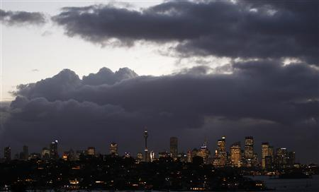 The Sydney's central business district with its lights on is seen from east Sydney in this June 15, 2011 file photo. Australia faces a gathering threat to its 21-year run of recession-free growth that will likely require the central bank to cut interest rates to record lows and keep them there for some time, if the winning streak is to stretch to 22. REUTERS/Daniel Munoz/Files