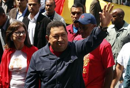Venezuela's President and presidential candidate Hugo Chavez waves as he arrives at a school to cast his vote during the presidential election in Caracas October 7, 2012. Chavez loyalists blew bugles in a wake up call for voters on Sunday as the Venezuelan leader faced the biggest electoral challenge yet to his socialist rule from a young rival, Henrique Capriles, tapping into discontent over crime and cronyism. REUTERS/Edwin Montilva