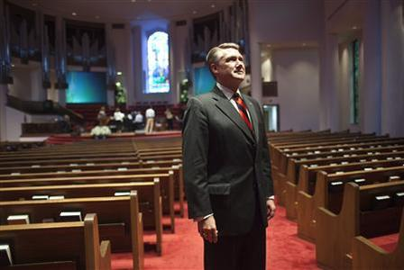Pastor Mark Harris of First Baptist Church stands for a portrait in the sanctuary prior to giving his sermon during the fifth and largest ''Pulpit Freedom Sunday'' in Charlotte, North Carolina October 7, 2012. More than 1,300 pastors across the country climbed to the lectern just weeks before the U.S. presidential and congressional elections, to urge people to vote for or against particular candidates. Such pulpit pleading could endanger a church's tax-exempt status by violating IRS rules. A charity can take a position on policy issues but cannot act ''on behalf of (or in opposition to) any candidate for public office.'' REUTERS/John Adkisson