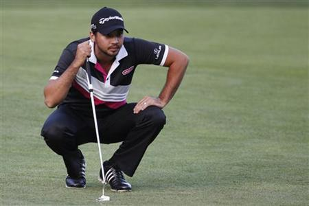 Jason Day of Australia lines up a putt at the 9th hole during the second round of the Deutsche Bank Championship golf tournament in Norton, Massachusetts September 1, 2012. REUTERS/Dominick Reuter