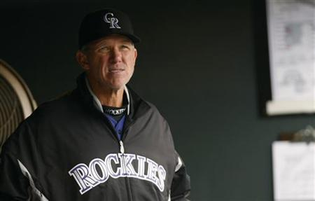 Colorado Rockies manager Jim Tracy reacts in the dugout after the Rockies pitched their seventh walk against the New York Mets in the fifth inning in their MLB National League baseball game in Denver May 12, 2011. REUTERS/Rick Wilking