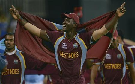 West Indies' captain Darren Sammy celebrates on a lap of honour after winning the world Twenty20 final cricket match against Sri Lanka at R Premadasa Stadium, Colombo October 7, 2012. REUTERS/Philip Brown