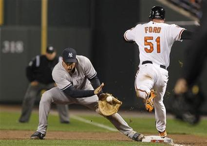 New York Yankees' Mark Teixeira (L) makes a catch to force out Baltimore Orioles' Lew Ford (R) at first base after Ford hit a sacrifice bunt during the fifth inning during Game 1 in their MLB ALDS playoff baseball series in Baltimore, Maryland October 7, 2012. REUTERS/Tim Shaffer