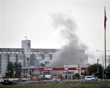 Smoke rises at the Akcakale border gate after a shell fired from Syria landed on the Turkish-Syrian border in Sanliurfa province October 7, 2012. REUTERS/Veli Gurgah/Anadolu Agency