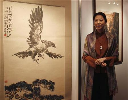 Yannan Wang, daughter of former Chinese Premier Zhao Ziyang and Director and President of China Guardian Auctions, the oldest auction house in mainland China, poses in front of a painting by Chinese painter Xu Beihong in Hong Kong September 5, 2012. REUTERS/Bobby Yip/Files