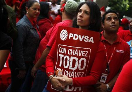 A Venezuelan worker from state oil company PDVSA takes part in a protest against U.S. sanctions against the company in Caracas May 25, 2011. REUTERS/Jorge Silva