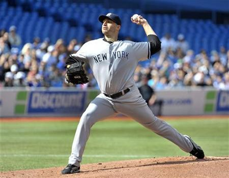 New York Yankees pitcher Andy Pettitte throws against the Toronto Blue Jays during the first inning of their MLB American League baseball game in Toronto September 29, 2012. REUTERS/Mike Cassese