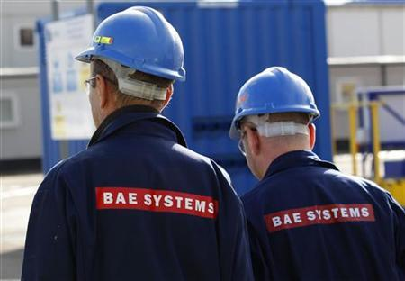 BAE Systems employees walk together at Roysth naval yard in Rosyth, Scotland October 2, 2012. REUTERS/David Moir