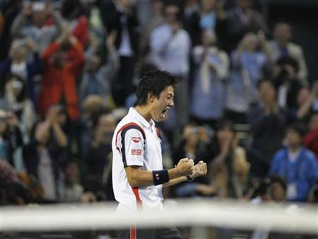 Kei Nishikori of Japan reacts after his win over Milos Raonic of Canada in the men's singles finals match at the Japan Open tennis championships in Tokyo, October 7, 2012. REUTERS/Yuriko Nakao