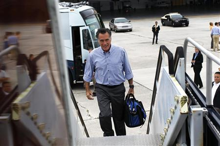 Republican presidential nominee Mitt Romney leaves his campaign bus to board his charter plane in West Palm Beach, Florida October 7, 2012. REUTERS/Shannon Stapleton