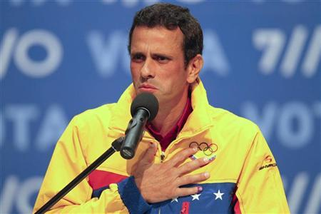 Venezuela's opposition presidential candidate Henrique Capriles gives a news conference after the results of the election awarded President Hugo Chavez with a victory, at Capriles' press center in Caracas October 7, 2012. REUTERS/Carlos Garcia Rawlins
