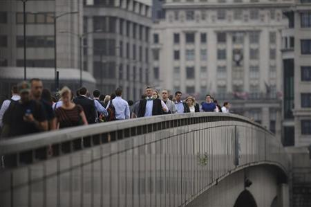 Commuters walk towards the financial district via London Bridge, three days after the end of the London 2012 Olympics August 15, 2012. REUTERS/ Ki Price