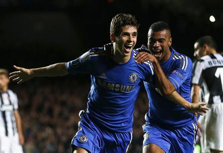 Chelsea's Oscar (L) celebrates with team mate Ashley Cole after scoring a goal against Juventus during their Champions League soccer match at Stamford Bridge in London September 19, 2012. REUTERS/Eddie Keogh