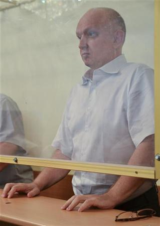 Vladimir Kozlov, leader of the unofficial political party Alga!, stands in the defendant's holding cell during his trial in the Kazakh city of Aktau August 16, 2012. REUTERS/Mariya Gordeyeva