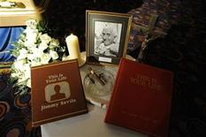A tribute is seen next to the coffin of British entertainer Jimmy Saville as it is displayed to the public at The Queens Hotel in Leeds, northern England November 8, 2011. REUTERS/Nigel Roddis