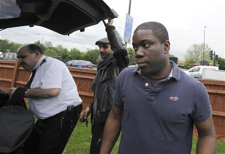 Former UBS trader Kweku Adoboli leaves a prison van in a Wandsworth McDonalds Drive Thru after being granted bail, in south London 12th June 2012. REUTERS/ Ki Price