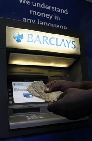 A man withdraws U.S. Dollar notes form a Barclays automated teller machine (ATM) in the capital Harare July 3, 2012. REUTERS/Philimon Bulawayo