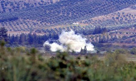 Smoke rises after a mortar bomb fired from Syria landed in Turkish soil on the Turkish-Syrian border in southern Hatay province October 8, 2012. REUTERS/Aykut Unlupinar/Anadolu Agency