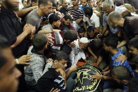 Palestinians mourn during the funeral of Mohammed Makawi at a mosque in Rafah in the southern Gaza Strip October 8, 2012. REUTERS/Ahmed Zakot