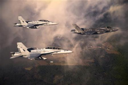 A U.S. Marine Corps F-35 Lightening II multirole fighter jet (R) is escorted by two USMC F-18 Hornets as it flies towards Eglin Air Force Base, Florida in this U.S. Air Force handout photo dated January 11, 2012. REUTERS/DoD/U.S. Air Force/Staff Sgt. Joely Santiago/Handout