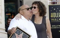 Actor Danny DeVito and his wife Rhea Perlman kiss as they pose on his star after it was unveiled on the Walk of Fame in Hollywood, California in this August 18, 2011 file photo. REUTERS/Mario Anzuoni/Files