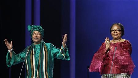 Nobel Peace Prize winners, Liberian peace activist Leymah Gbowee (R) and Liberian President Ellen Johnson-Sirleaf (L), appear on stage during the annual Nobel Peace Prize Concert in Oslo December 11, 2011. REUTERS/Leonhard Foeger